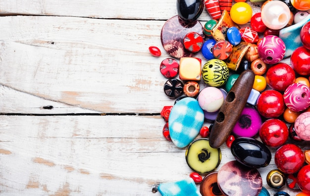 Colorful beads on wooden surface