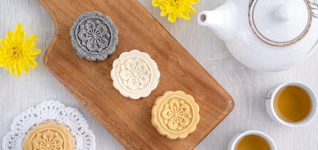 Colorful beautiful moon cake, mung bean cake, champion scholar pastry cake for mid-autumn festival traditional gourmet dessert snack, top view, flat lay.