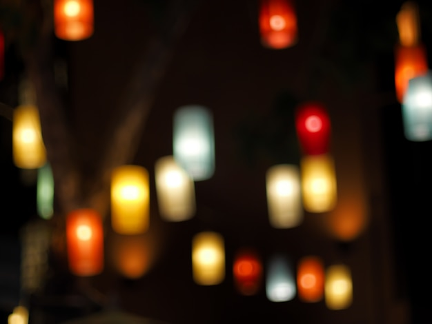 Colorful of beautiful traditional lamp lantern in the dark blur black background