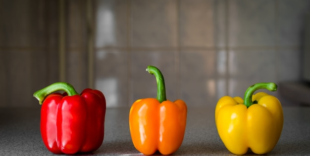 Colorful bell peppers on table