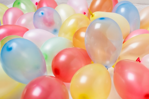 Colorful birthday balloons close-up background