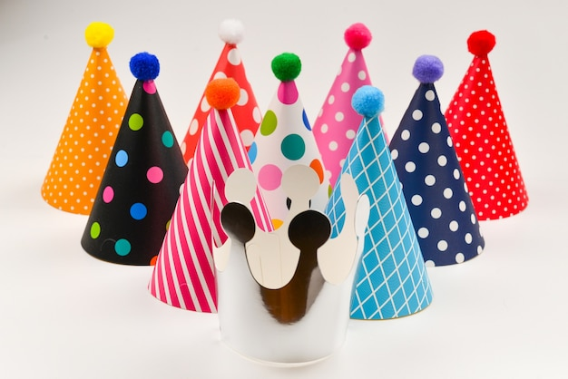 Colorful birthday caps on a white background.