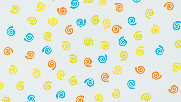 Colorful birthday ornaments on white background