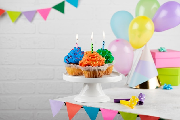 Colorful birthday party cupcakes with candles