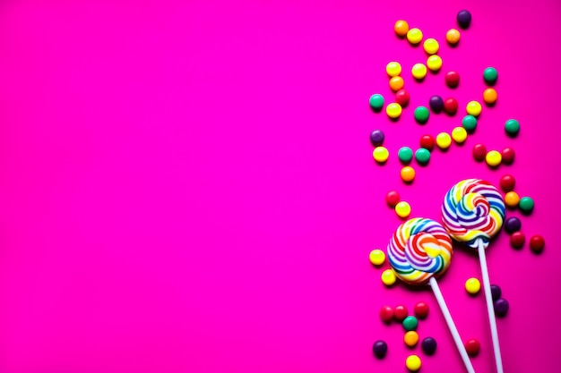 Colorful birthday party flat lay background with copyspace. neon backdrop.