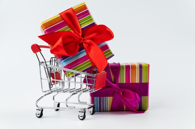Colorful black friday gift in shopping cart