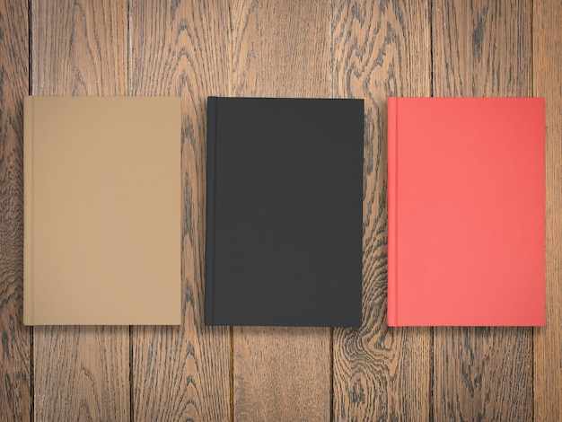 Colorful blank books on wood table