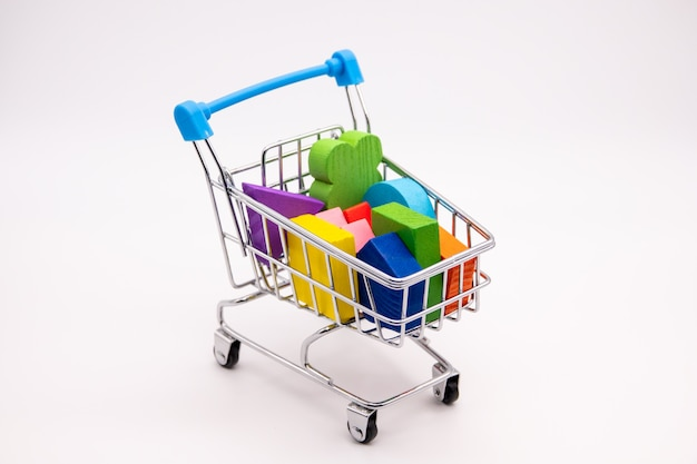 Colorful blocks in a small shopping cart
