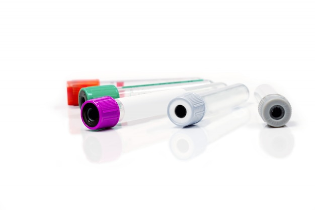 Colorful blood tubes for keep and safe blood collection to checkup glucose and all virus on white background with refection shadow. each colors caps used for keep different types of blood and liquid.