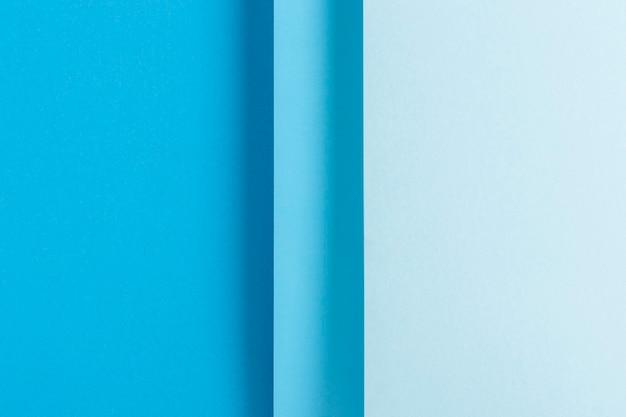 Красочный синий дизайн материала сложенной бумаги. вид сверху, плоская планировка.