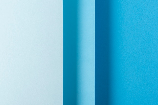 Красочный синий сложенный бумажный материал дизайн вертикально. вид сверху, плоская планировка.