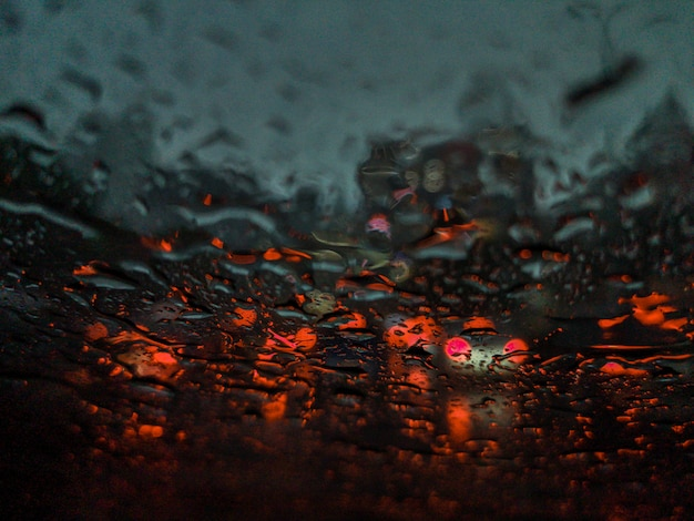 Colorful blurred abstract background from traffic jam on the road and rain.