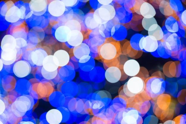 休日の背景のカラフルなぼやけた抽象的なライト