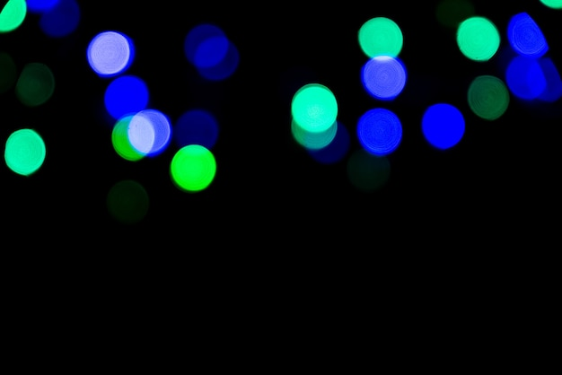 The colorful bokeh on the blurred natural black background.