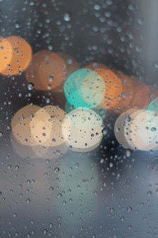 Colorful bokeh in window while raining