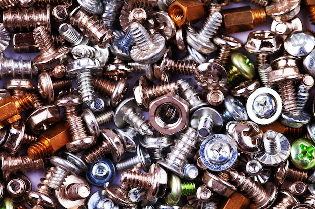 Colorful bolts and nuts screws texture background