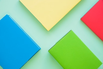 Colorful books on mint background