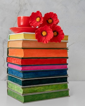 Colorful books stack with flowers