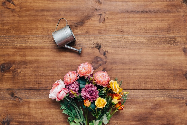 Colorful bouquet with watering can