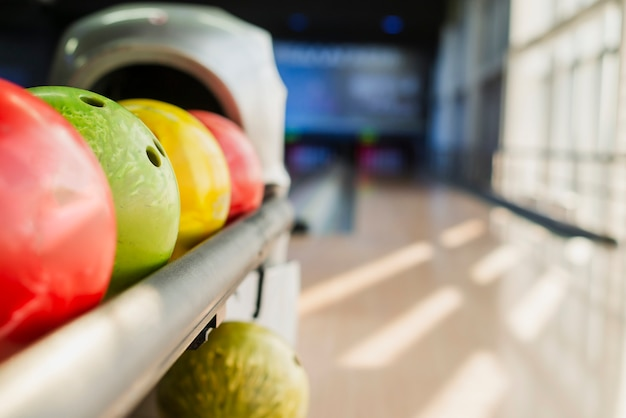 Colorful bowling balls on blurred alley