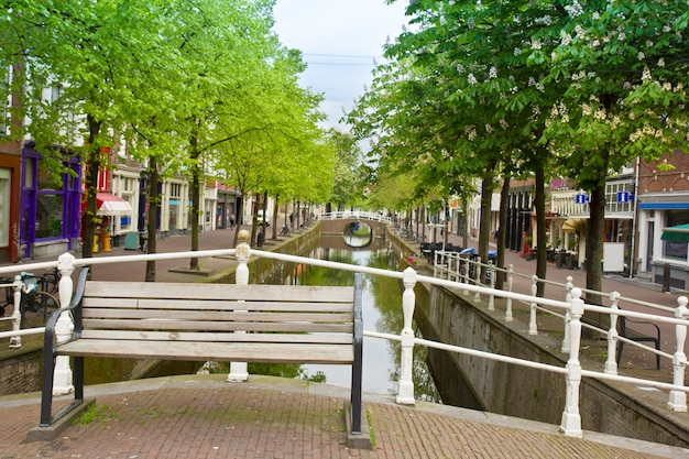 Colorful bridge with bench  in old town  of delft, holland