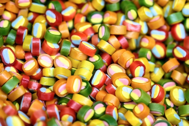 Colorful bright candy, children's joy. the composition of a variety of chocolates by weight in trays.