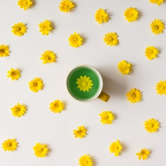 Colorful bright tea and yellow flowers pattern. flat lay.