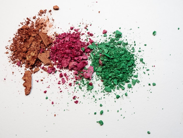 The colorful of broken eyeshadow put on white background.show color and texture of product.
