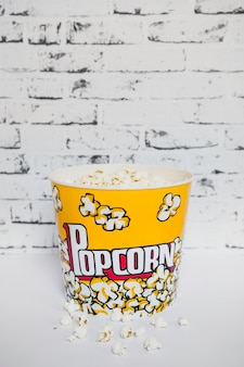 Colorful bucket of popcorn on white