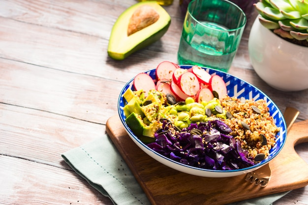 Colorful buddha bowl with veggies and quinoa