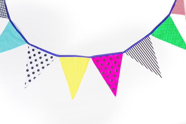 Colorful bunting flags on white background