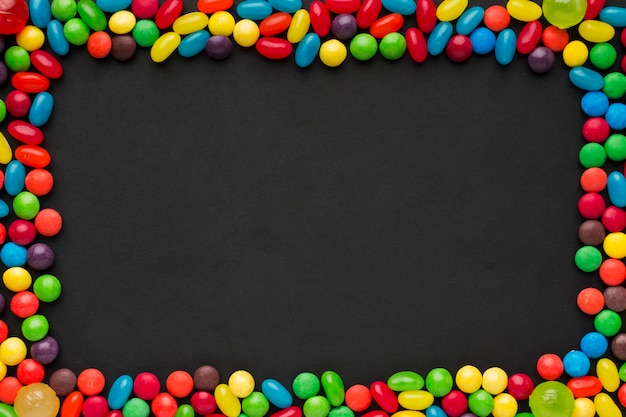 Colorful candies frame with copy space