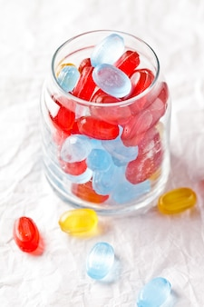 Colorful candies in glass jar