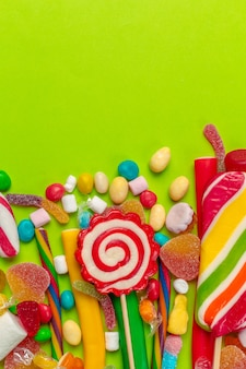 Colorful candies on green