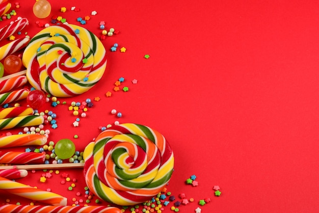 Colorful candies on a red