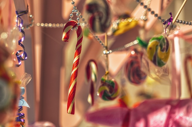 Colorful candies and sweets are hung as decorations closeup