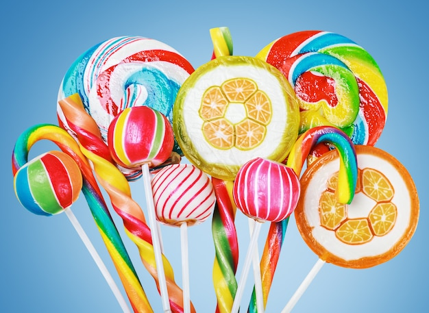 Colorful candies and sweets on a blue