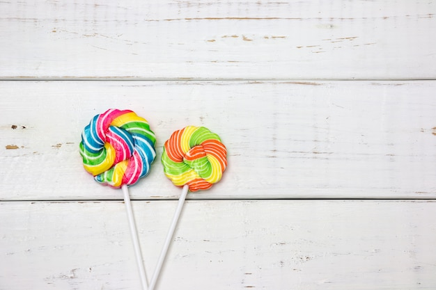 Colorful candies on wooden table background. top view with copy space