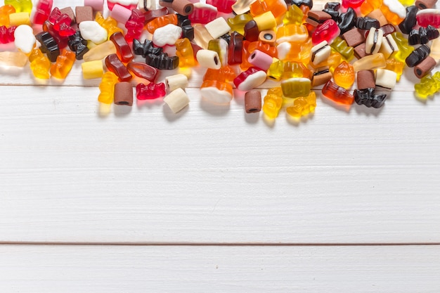 Colorful candies on wooden