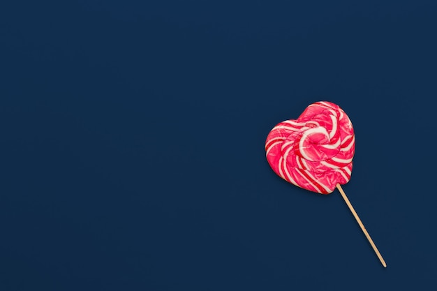 Colorful candy on classic blue background top view