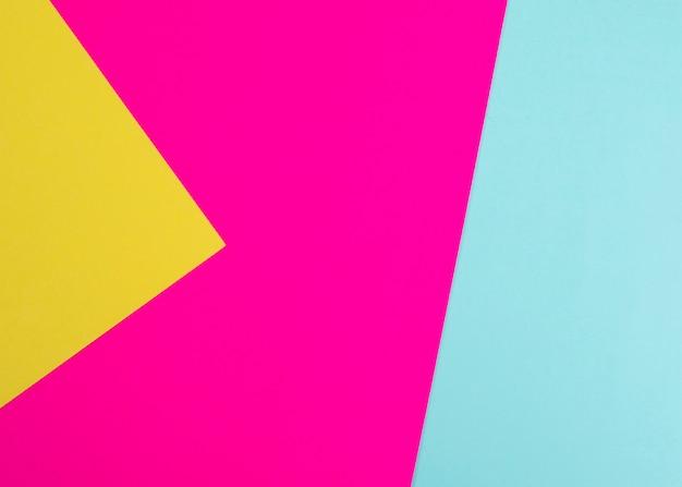 Красочный картон на бумажном фоне фукси, желтый и светло-зеленый