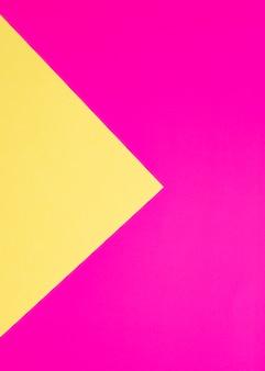 カラフルな段ボール紙の背景フクシアと黄色