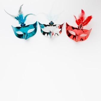 Colorful carnival masks with copy space