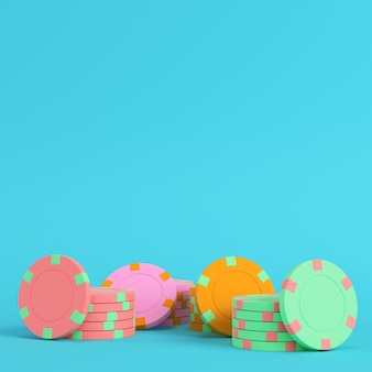 Colorful casino chips on bright blue background