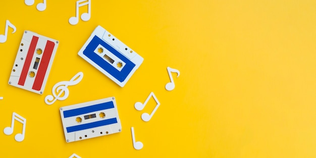 Colorful cassette tapes on bright background with copy-space