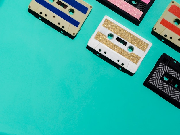 Colorful cassette tapes in corner with copy-space