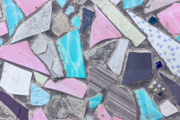 Colorful ceramic fragments and cement floor