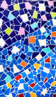 Colorful ceramic and stained glass wall background at wat phra that pha son kaew