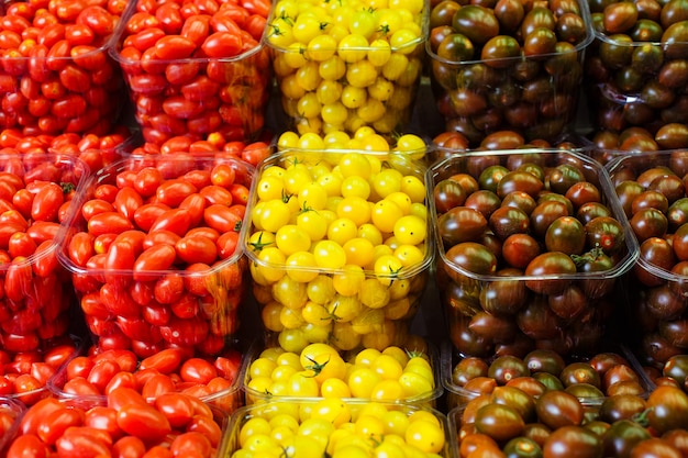 Colorful cherry tomatoes in plastic baskets
