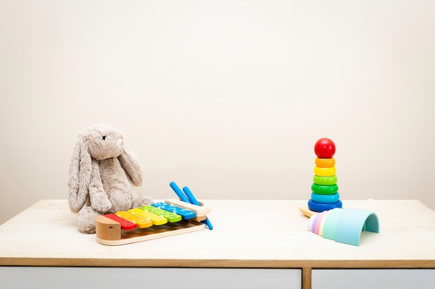 Of colorful children's toys against the wall toys on wood table with copyspace